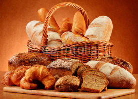 Naklejki Wicker basket with variety of baking products