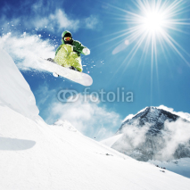 Fototapety Snowboarder at jump inhigh mountains