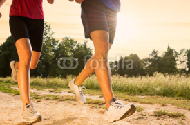 Obrazy i plakaty Young Couple Jogging in Park