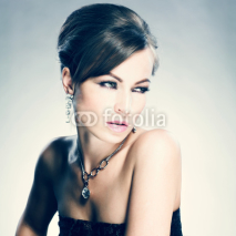 Fototapety Beautiful woman with evening make-up. Jewelry and Beauty