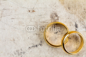 Fototapety Wedding rings on dirty canvas