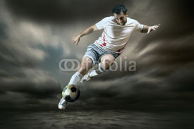Fototapety Football player with ball on field of stadium