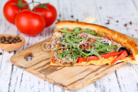 Fototapety Piece of pizza with arugula