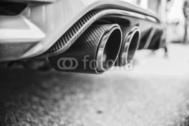 Obrazy i plakaty Double exhaust pipes of a modern sports car, black and white