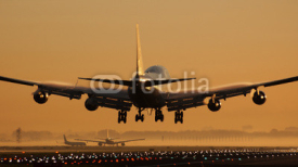 Fototapety Airplane sunrise landing