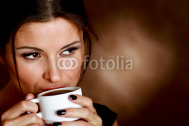 Fototapety Woman with an aromatic coffee in hands