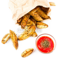 Naklejki French fries potato wedges with hot red  sauce in recycled kraft