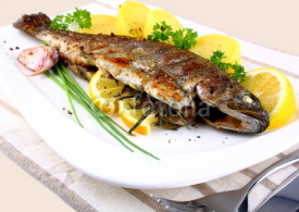 Fototapety Grilled whole trout with potato, lemon and garlic