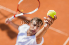 Fototapety Young man playing tennis