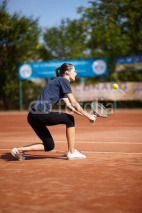 Fototapety Tennis player executing a backhand volley