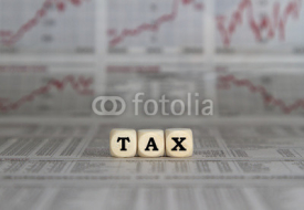 Fototapety Tax word with calculator on newspaper background