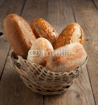 Fototapety Bakery product assortment with bread loaves and buns
