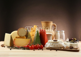 Obrazy i plakaty Tasty dairy products on wooden table, on dark background