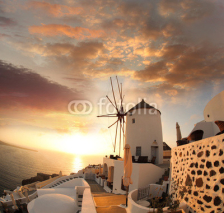 Naklejki Windmill in Santorini against sunset, Greece