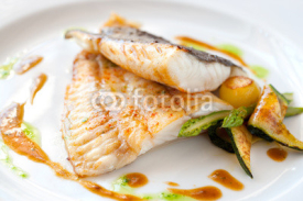 Fototapety Grilled turbot fish with vegetables.