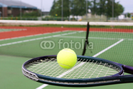 Fototapety Tennis racket and ball on court