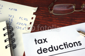 Fototapety Tax deductions written on a paper. Financial concept.