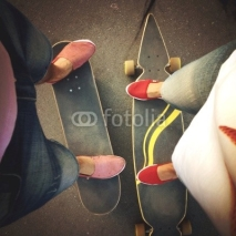 Fototapety a boy's and girl's legs on boards