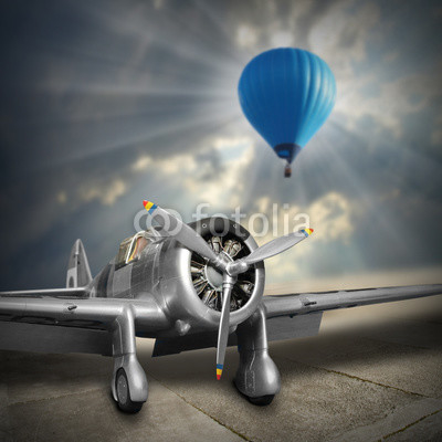 Old aircraft and hot air baloon. Retro style picture on aviation theme.