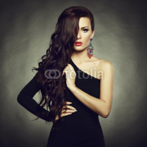Fototapety Portrait of beautiful brunette woman in black dress