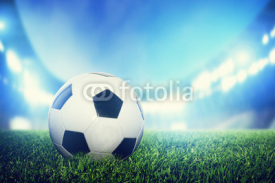 Fototapety Football, soccer match. A leather ball on grass on the stadium