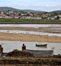 Fototapety Small town and fishing - boat on low-tide