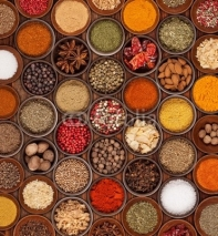 Fototapety Various kinds of spices on wooden background