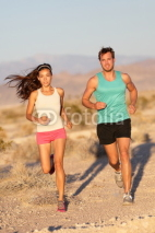 Obrazy i plakaty Running couple - runners jogging on trail run path