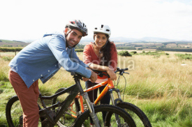 Fototapety Young Couple Cycling In Countryside