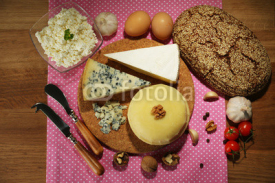 Obrazy i plakaty Still life with dairy products and bread on wooden table