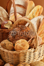 Fototapety Composition with bread and rolls in wicker baskets