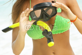 Naklejki Woman is holding a mask for snorkeling