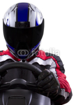 Obrazy i plakaty racerwearing red racing suit and blue helmet on a steering wheel