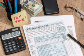 Fototapety tax form with calculator, money and pen
