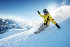 Naklejki Freeride snowboarding photo in deep powder