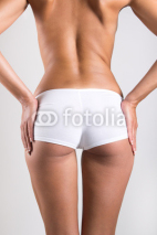 Naklejki Woman with perfect body checking cellulite