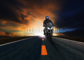 Naklejki young man riding motorcycle on asphalt road
