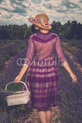 Woman in purple dress and hat with basket