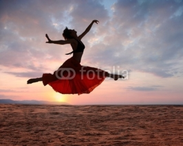 Fototapety Jumping woman at sunset