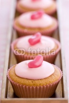 Fototapety Row of pink cupcakes