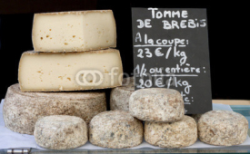 Obrazy i plakaty Stack of Biger France Cheese sale im the market.
