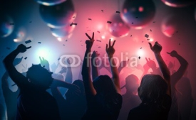 Obrazy i plakaty Young happy people are dancing in club. Nightlife and disco concept.