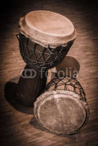 Naklejki Traditional wooden african djembe drumon stage