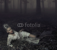 Naklejki Blond beauty laying on leaves