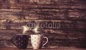 Fototapety Two tea or coffee cup on wooden table.