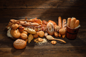 Naklejki Variety of bread on old wooden background.