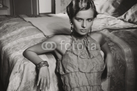 Obrazy i plakaty Portrait of a beauty woman in stylish room in black and white