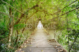 Naklejki Old wooden suspension bridge with rope for walking across river in the rainforest of Khao Yai National park. Thailand.