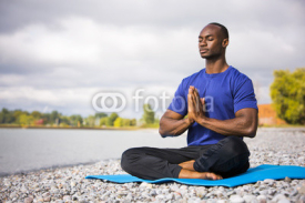 Fototapety young man exercising yoga