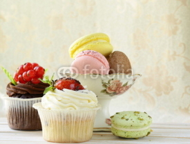 Fototapety holiday desserts, cupcakes and macaroons on a vintage background